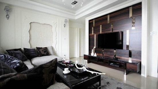 设计重点:电视主墙 编辑点评:深色木纹与茶镜错落